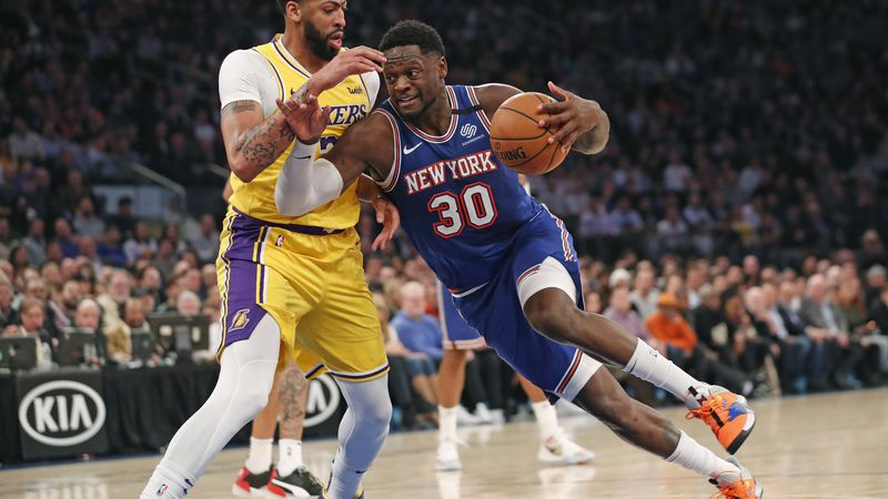 Los Angeles Lakers forward Anthony Davis (3) defends New York Knicks forward Julius Randle (30)...