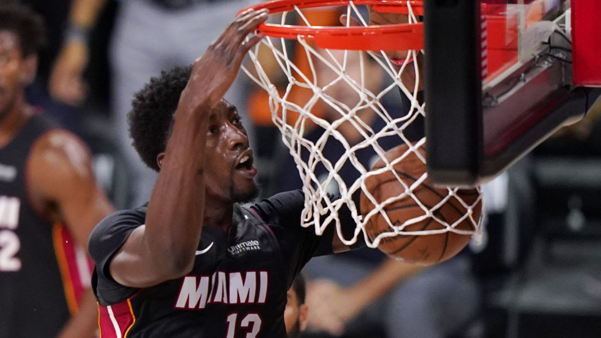 Miami Heat's Bam Adebayo (13) slams home a dunk during the first half of an NBA conference final playoff basketball game against the Boston Celtics Sunday, Sept. 27, 2020, in Lake Buena Vista, Fla. (AP Photo/Mark J. Terrill)