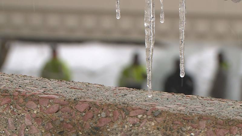 An icicle hangs near the scene of a parking garage that collapsed due to the weight of snow and...