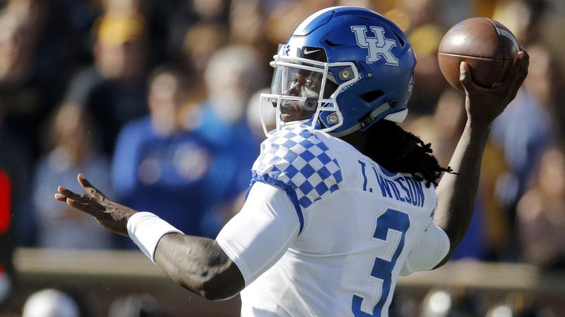 Kentucky quarterback Terry Wilson passes during the first half of an NCAA college football...