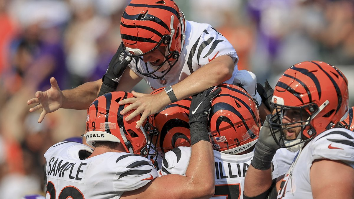 Cincinnati Bengals kicker Evan McPherson (2) is lifted by teammates after hitting a field goal...
