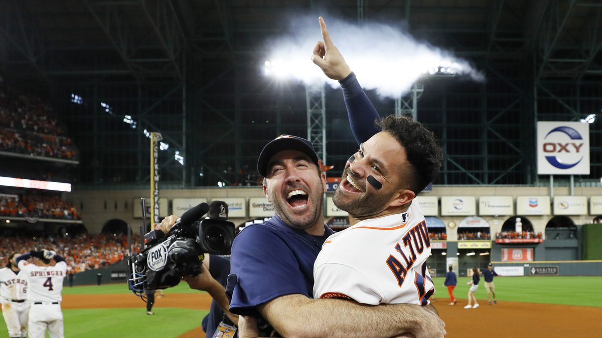 Houston Astros' Jose Altuve, right, and starting pitcher Justin Verlander celebrate after winning Game 6 of baseball's American League Championship Series against the New York Yankees Saturday, Oct. 19, 2019, in Houston. The Astros won 6-4 to win the series 4-2. (AP Photo/Matt Slocum)