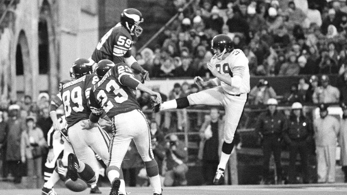 In this Jan. 12, 1975 file photo, Minnesota Vikings' Matt Blair (59) goes high to block the...