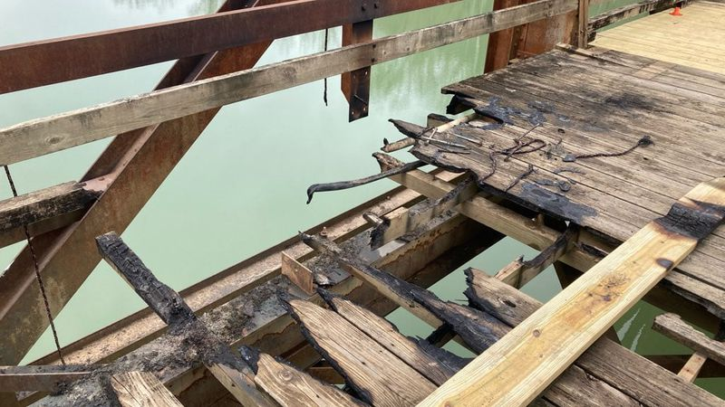 Someone was able to get in recently and set fire to a historic walking bridge over the...