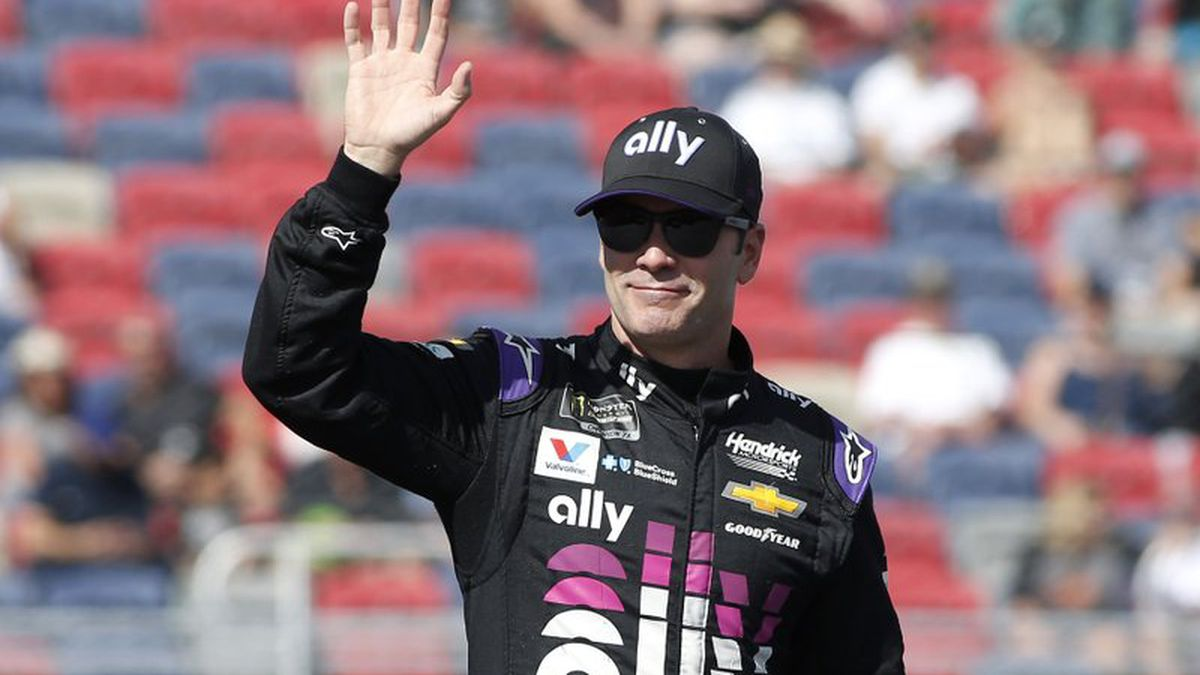 FILE - In this Nov. 10, 2019, file photo, Jimmie Johnson waves during driver introductions prior to the NASCAR Cup Series auto race at ISM Raceway in Avondale, Ariz. Seven-time NASCAR champion Jimmie Johnson says 2020 will be his final season of full-time racing. The winningest driver of his era will have a 19th season in the No. 48 Chevrolet and once again chase a record eighth championship. Johnson made the announcement in a video posted on social media, Wednesday, Nov. 20, 2019. (AP Photo/Ralph Freso, File)