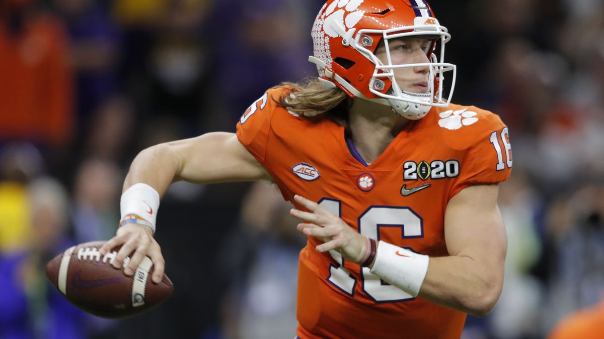 FILE - In this Jan. 13, 2020, file photo, Clemson quarterback Trevor Lawrence passes against LSU during the second half of a NCAA College Football Playoff national championship game, in New Orleans. Clemson is preseason No. 1 in The Associated Press Top 25, Monday, Aug. 24, 2020, a poll featuring nine Big Ten and Pac-12 teams that gives a glimpse at what's already been taken from an uncertain college football fall by the pandemic. (AP Photo/Gerald Herbert, File)