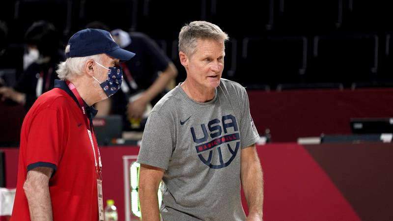 United States head coach Gregg Popovich, left, and assistant coach Steve Kerr talk during a...