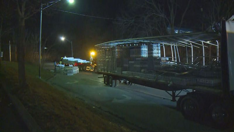 A semi hauling thousands of chickens hit a bridge, shutting down North Broadway in Lexington.