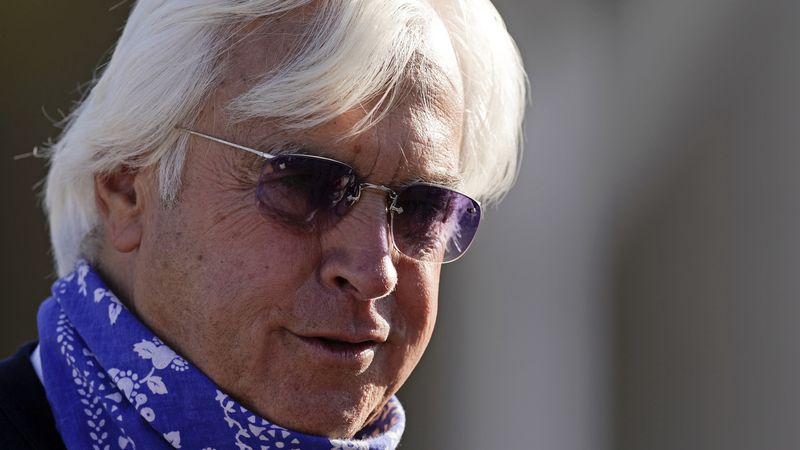 Bob Baffert, trainer for Kentucky Derby hopeful Medina Spirit, talks to a reporter outside his...