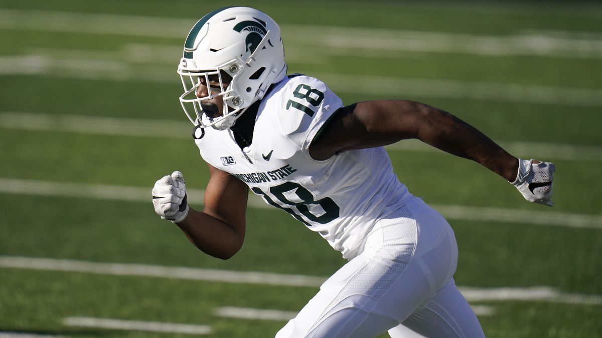 Michigan State wide receiver Tre'Von Morgan runs up field during the second half of an NCAA...