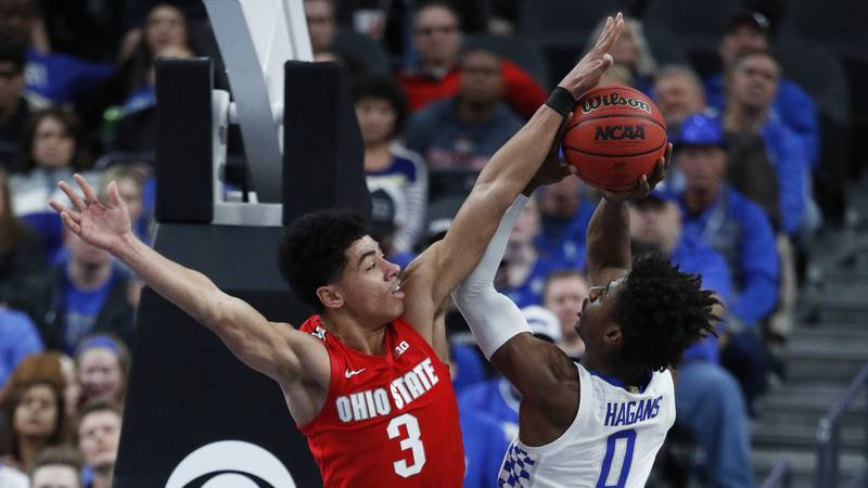 Ohio State's D.J. Carton (3) blocks a shot by Kentucky's Ashton Hagans (0) during the second...