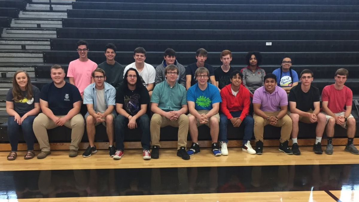 9 of the 10 twins sat for a photo ahead of Boyle County High School's May 25 graduation. (Phil...