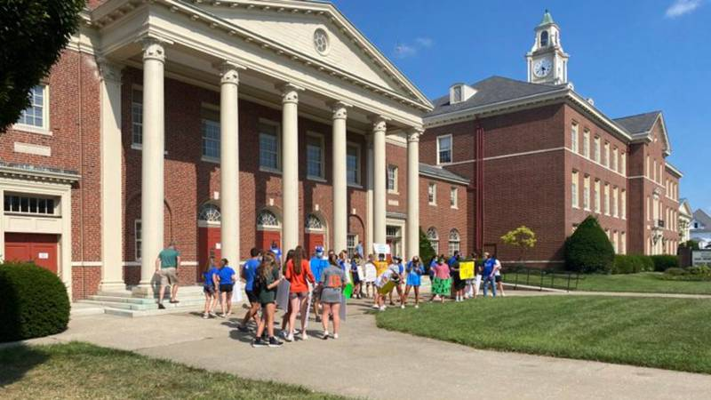 A group of students gathered outside of the Fayette County Public Schools Central Office,...