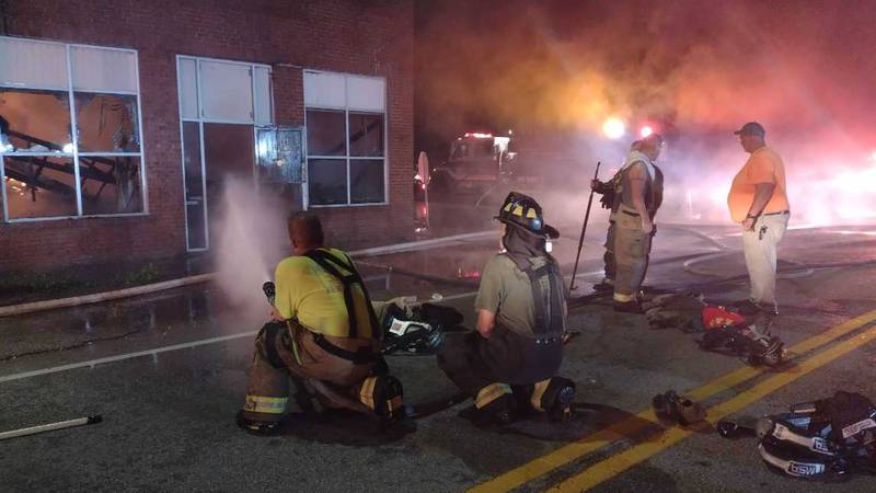 Firefighters battle a fire in downtown Clay City, Ky. on Sunday, August 29, 2021.