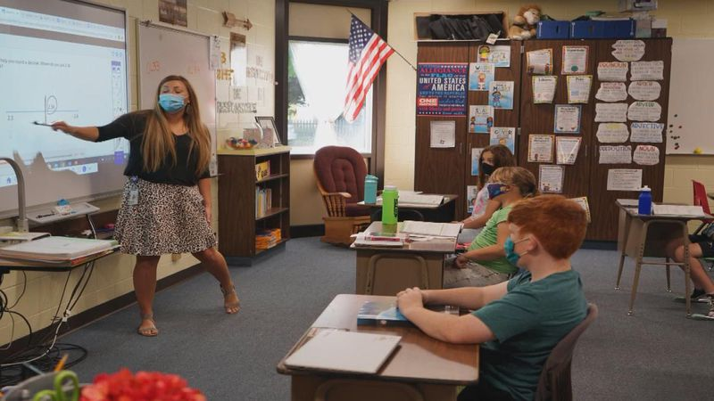 School officials tell us that when talks began about a return to in-person learning, masks were...