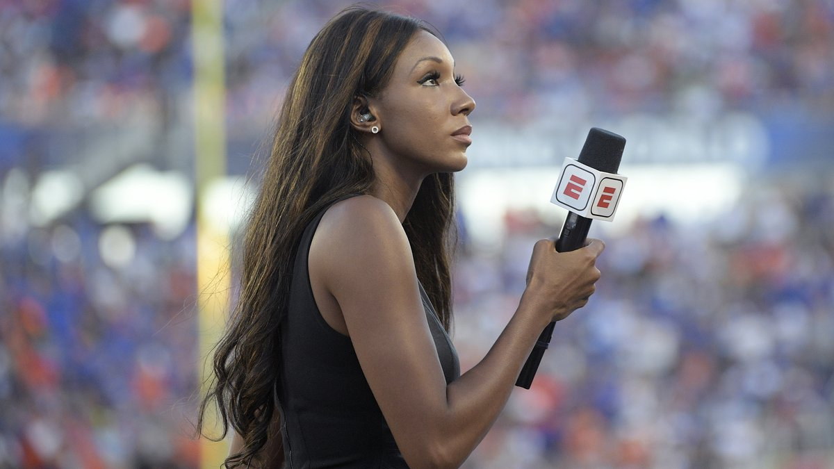 FILE - In this Aug. 24, 2019, file photo, ESPN's Maria Taylor works from the sideline during...
