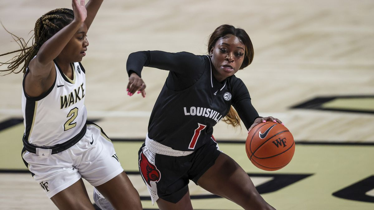 Louisville guard Dana Evans (1) drives around Wake Forest guard Kaia Harrison (2) in the first...