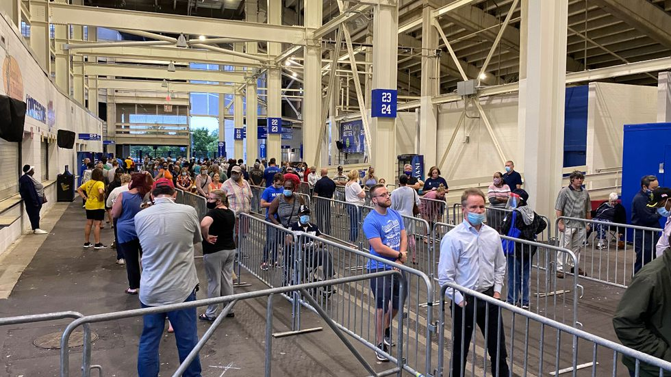 Lines formed early for in-person voting at Kroger Field, the only polling location in Lexington.