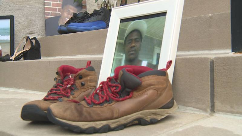 Pictures and shoes of gun violence victims lined the steps of the old courthouse in downtown...
