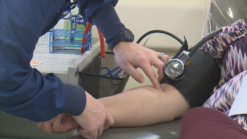 A women gives blood at the Kentucky Blood Center (WKYT)