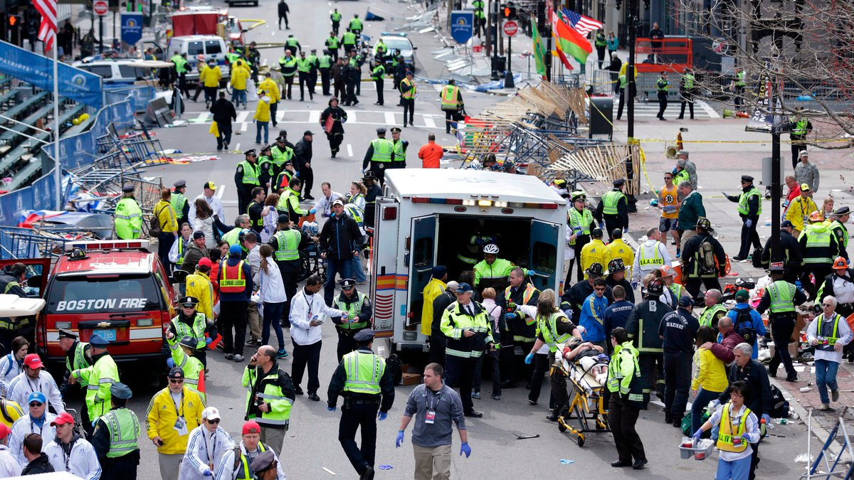 FILE - In this April 15, 2013, file photo, medical workers aid injured people following an...