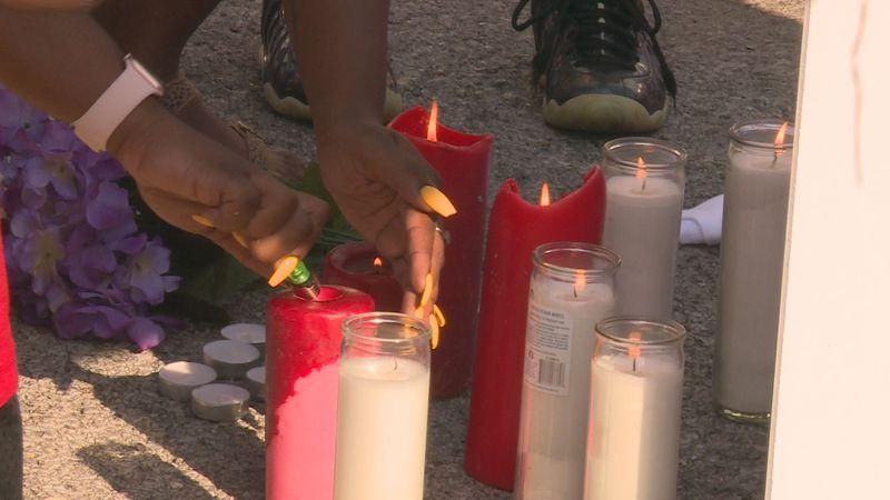 Loved ones lit candles in memory of Webb.