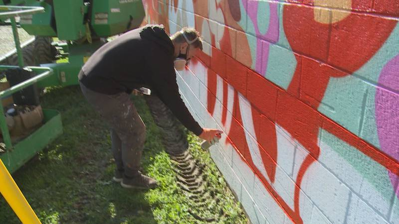 Kids at Harrison Elementary School will now have a work of art as their recess backdrop. It's...