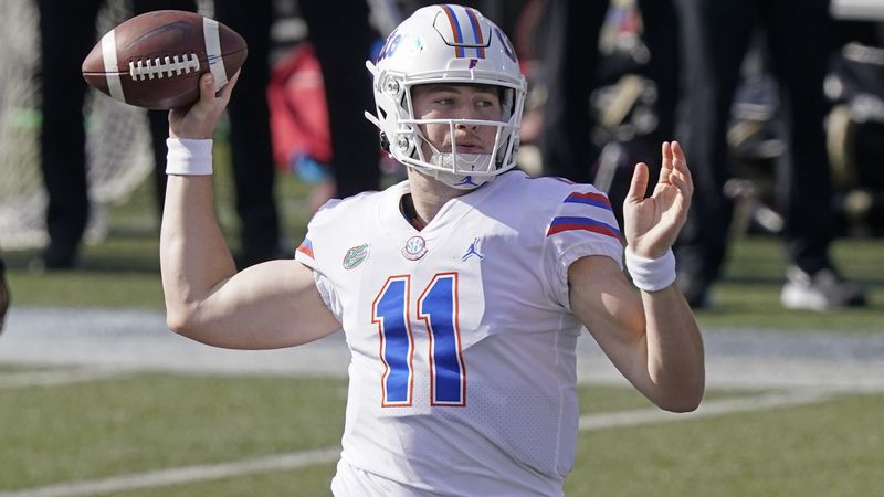 Florida quarterback Kyle Trask (11) passes against Vanderbilt in the first half of an NCAA...