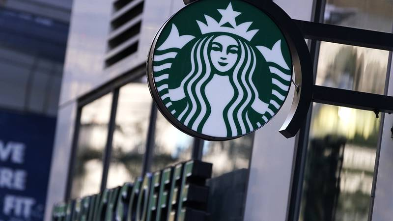Starbucks said it is raising its U.S. employees' pay and making other changes to improve...