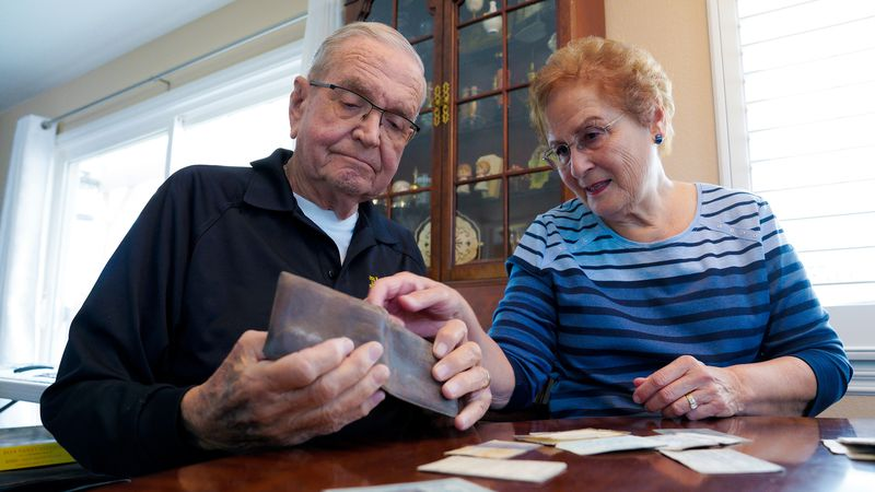 Paul Grisham and his wife Carole Salazar look over his wallet that he lost during his 13-month...