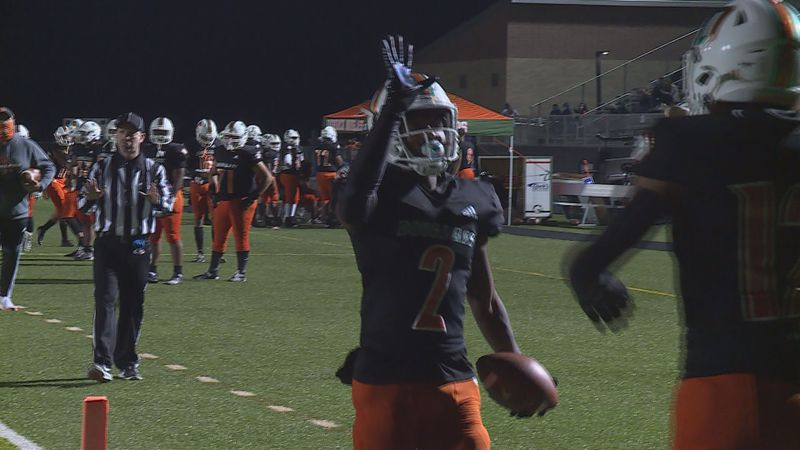Dekel Crowdus scores one of his two TDs