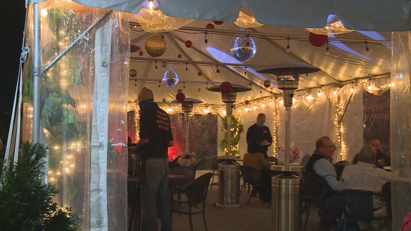 Co-Owner Gwyn Everly said they put up walls on the tent and added heaters, but they are now...