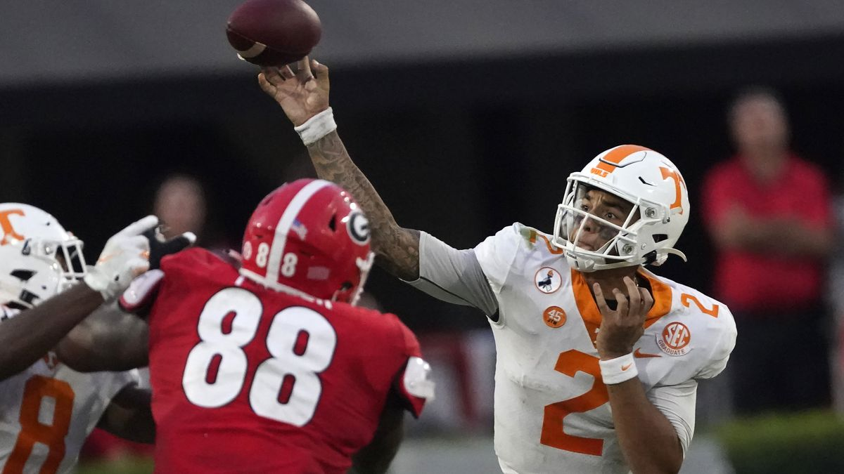 Tennessee quarterback Jarrett Guarantano (2) throws from the pocket in the second half of an NCAA college football game against Georgia Saturday, Oct. 10, 2020, in Athens, Ga. (AP Photo/John Bazemore)