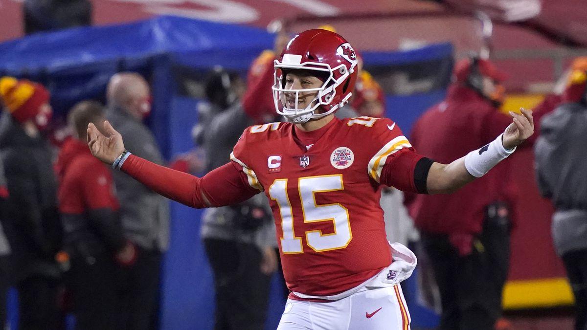 Kansas City Chiefs quarterback Patrick Mahomes celebrates after throwing a 5-yard touchdown...