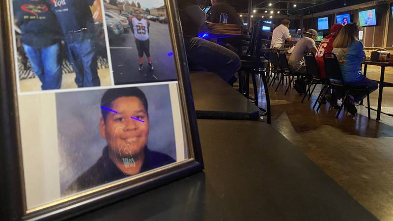 """Pictures of Christopher """"CJ"""" Gordon, Jr. and his family filled the Tipsy Cow Bar during a..."""