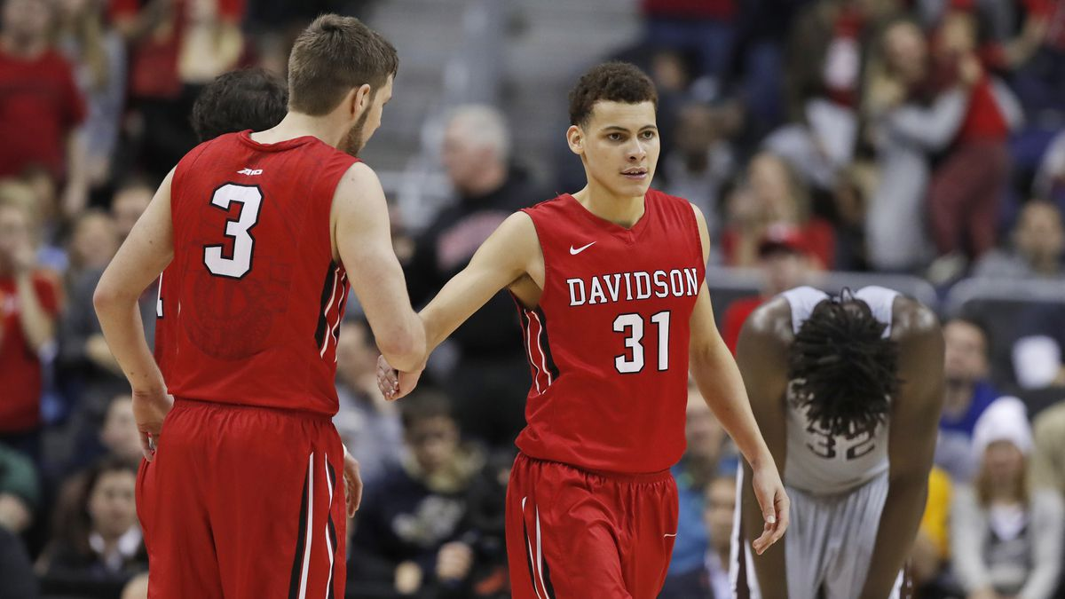 Davidson guards Jordan Watkins (2) and Kellan Grady (31) celebrate after a play as St....