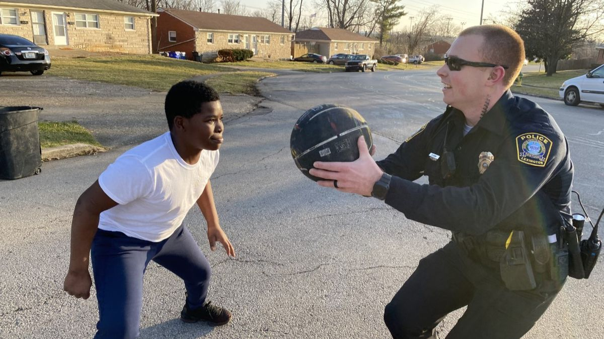 Officer Dunn says he patrols the Idle Hour area and has been playing basketball with the kids...