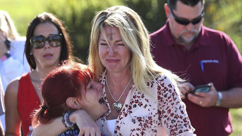 FILE- In this Feb. 14, 2018 file photo, parents wait for news after a shooting at Marjory...