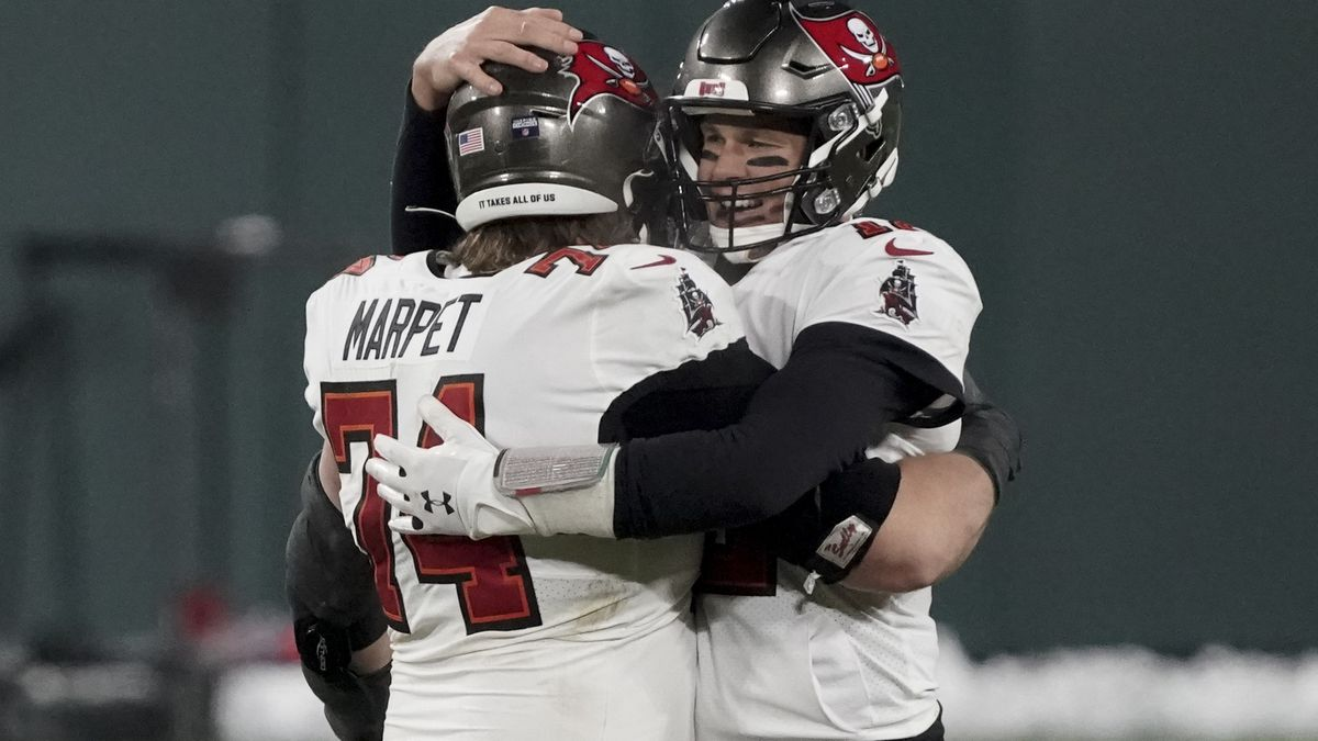 Tampa Bay Buccaneers quarterback Tom Brady (12) celebrates with Ali Marpet after winning the...