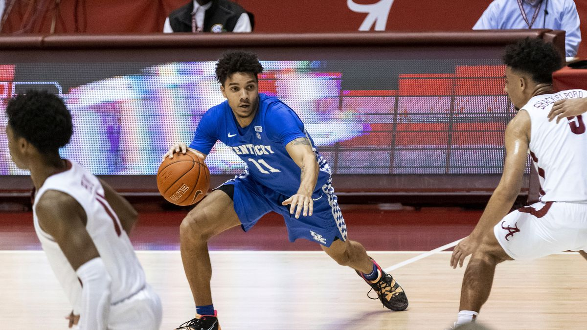 Kentucky guard Dontaie Allen (11) works against Alabama during the first half of an NCAA...
