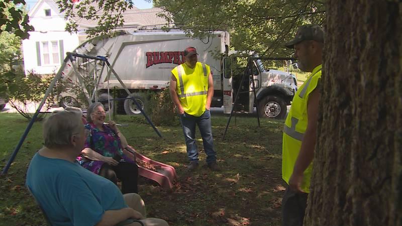 Two Rumpke sanitation workers in Millersburg, Ky. help save a man from burning hom.