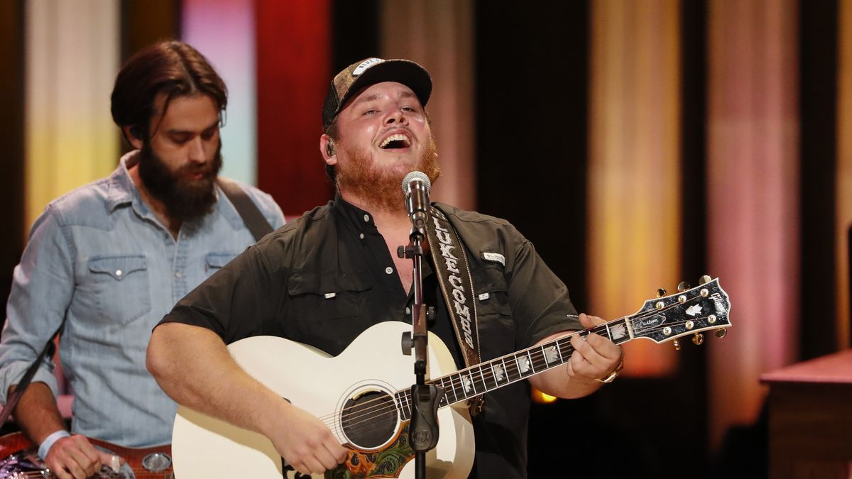 """Luke Combs performs at """"Luke Combs Joins the Grand Ole Opry Family,"""" at the Grand Ole Opry, Tuesday, July 16, 2019, in Nashville, Tenn. (Photo by Al Wagner/Invision/AP)"""