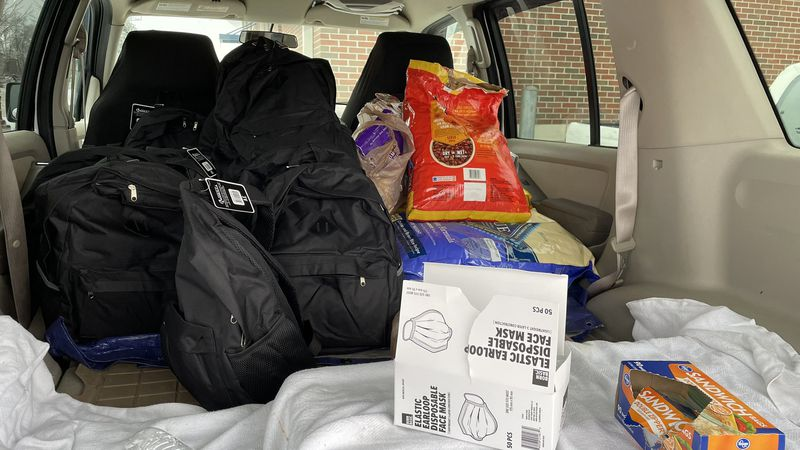 Backpack Blessings and Paws 4 the Cause hand out backpacks full of winter weather supplies to...