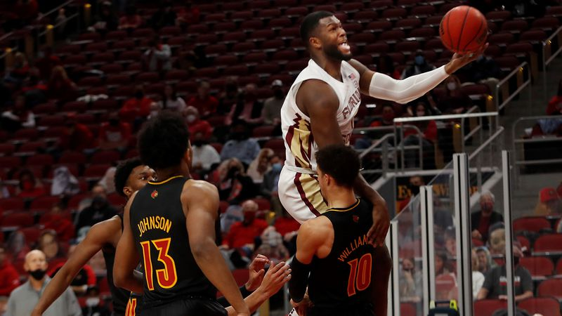 Florida State's RaiQuan Gray makes a shot over Louisville's Samuell Williamson.