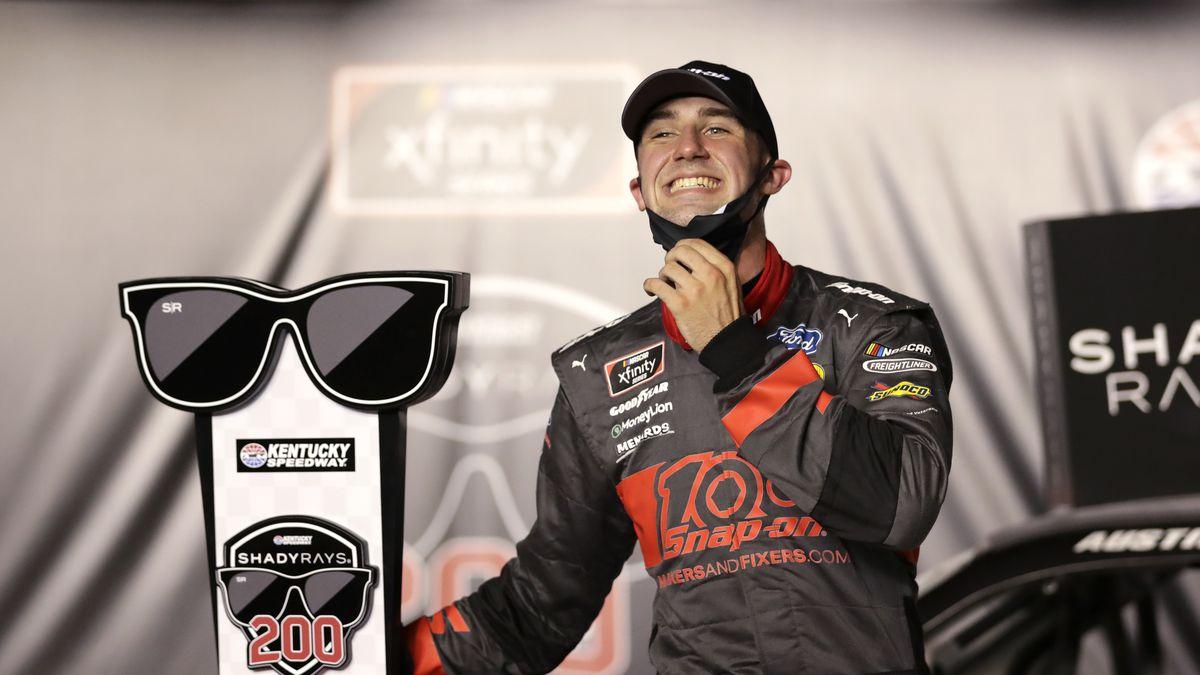 Austin Cindric celebrates his win after a NASCAR Xfinity Series auto race Thursday, July 9, 2020, in Sparta, Ky. (AP Photo/Mark Humphrey)