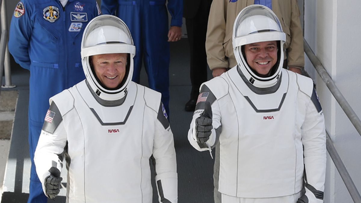 NASA astronauts Douglas Hurley, left, and Robert Behnken walk out of the Neil A. Armstrong Operations and Checkout Building on their way to Pad 39-A, at the Kennedy Space Center in Cape Canaveral, Fla., Saturday, May 30, 2020. (AP Photo/John Raoux)