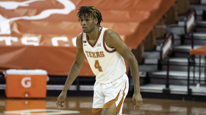 Texas forward Greg Brown plays during the second half of an NCAA college basketball game...