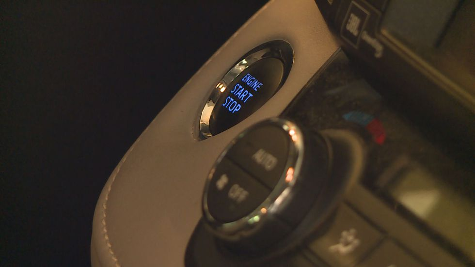 A push button start common in keyless ignition cars.