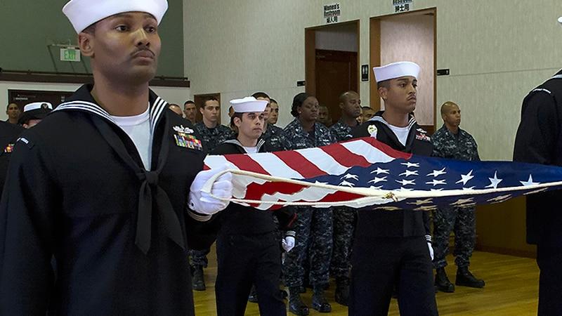 Sailors commemorate Veterans Day at Fleet Activities Yokosuka.