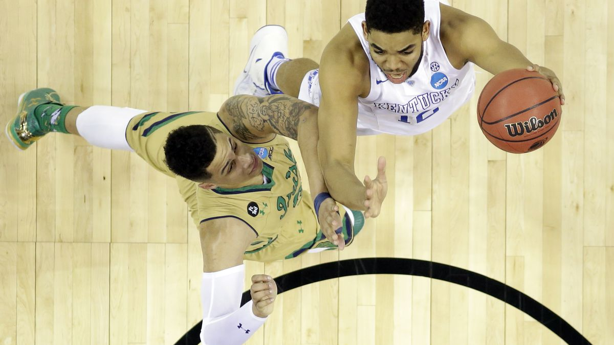 Kentucky's Karl-Anthony Towns, right, shoots over Notre Dame's Zach Auguste in the second half of a college basketball game in the NCAA men's tournament regional finals, Saturday, March 28, 2015, in Cleveland. (AP Photo/David Richard)